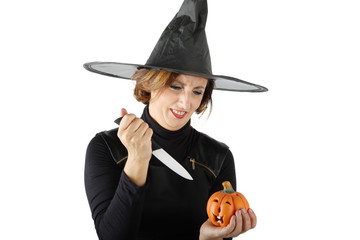 Witch with pumpkin and knife