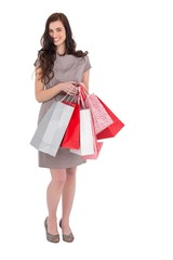 Elegant and smiling brunette with shopping bags