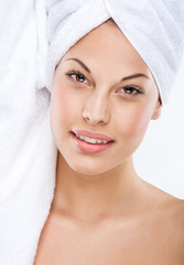 Beautiful Girl After Bath Touching Her Face.