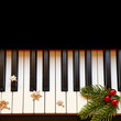 Christmas branch on piano keys - 72602861