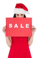 Brunette in red dress holding sale sign
