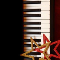 Christmas ornaments on piano keys