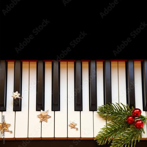 Christmas branch on piano keys - 72602861