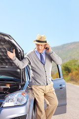 Mature man having a problem with his car