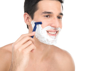 Close up of male shaving with razor on white background.