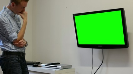 Man watches TV(television) - green screen - expressed sadness