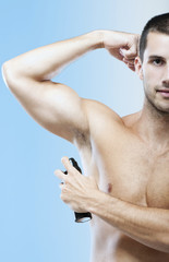 Young muscular man with deodorant