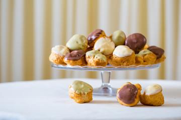 Profiterole, cream puff - French dessert choux pastry ball fille