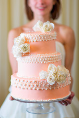 Wedding cake in bride's hands