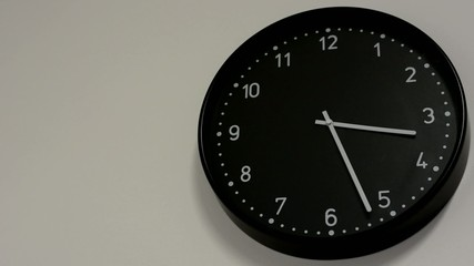 black clock on the white wall