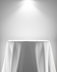 presentation pedestal covered with white silk cloth