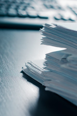 Stacks of paper on the office table