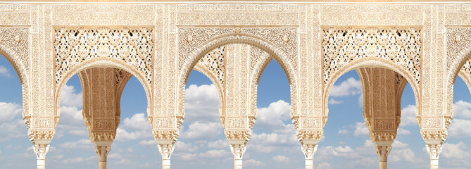 Arches in Islamic (Moorish)  style in Alhambra, Granada, Spain