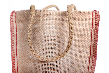 Hand is a part of  bag made out of recycled Hessian sack