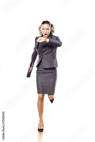 canvas print picture Excited business woman running and looking at her watch