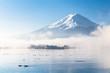 Mountain Fuji and Kawaguchiko lake with morning mist in autumn s