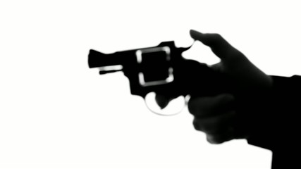 man shooting a handgun,real time,isolated,studio lighting