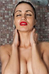 beautiful woman enjoying a shower