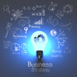Leinwanddruck Bild - business strategy and  light bulb with gears as concept