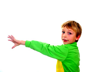 Young boy in studio in green cardigan on white background