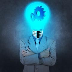 businessman has  light bulb haed with gears as concept