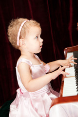 Little girl playing the piano