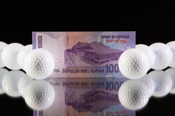 Indonesia money on the black glass desk
