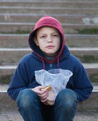 homeless boy eats cookies