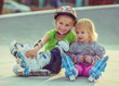 two little sisters in a roller skates - 72616822