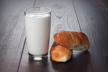 glass of milk and fresh buns