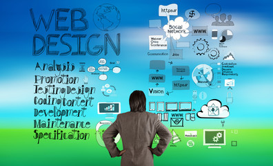 businessman looking at web design and diagram icons on blur natu