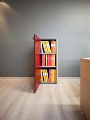 File cabinet open door and folders in modern office