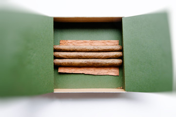 Luxury cigarillos in green luxury box for smokers