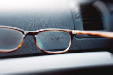 Car Airbag sign through eyewear glasses