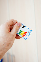 Power and Energy efficiency label in man hand