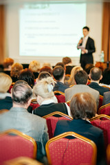 Business conference with speaker and audience room