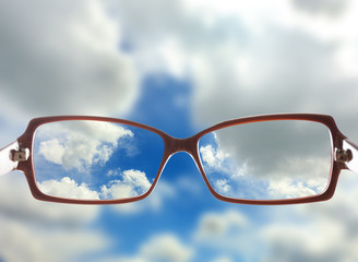 Vision concept. Glasses on sky background
