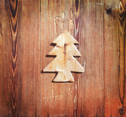 Close up of a piece of wood in the shape of a christmas tree