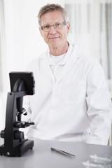 scientific researcher with microscope
