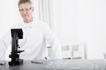 scientific researcher with microscope