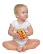 Fast food concept. Infant child baby toddler hold tasty unhealth