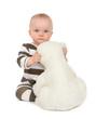 Infant child baby girl hugging soft teddy bear