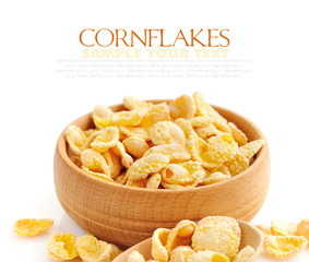 Cornflakes in a wooden bowl on white background