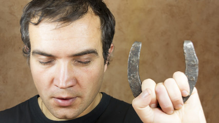 Man with lucky horseshoe