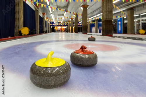 Fotobehang Wintersporten Curling stones on an indoor rink