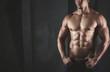 Leinwandbild Motiv Close up of young muscular man lifting weights