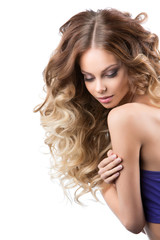 smiling girl with luxuriant hair curling. Health and Beauty.