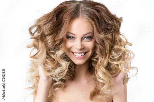 canvas print picture Portrait smiling girl with luxuriant hair curling.