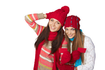 Two winter girls showing blank cards