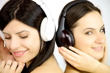 Two women enjoying music happy